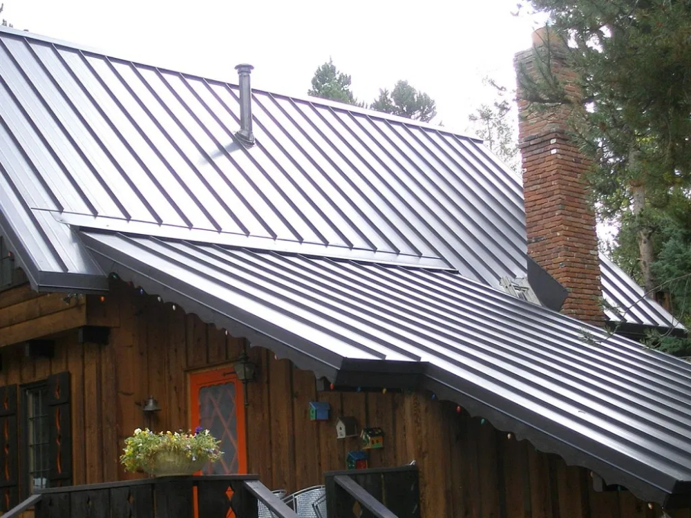 The Cost Of A Standing Seam Metal Roof Plus Pros Cons Home Remodeling Costs Guide Zinc Roof Standing Seam Metal Roof Metal Roof