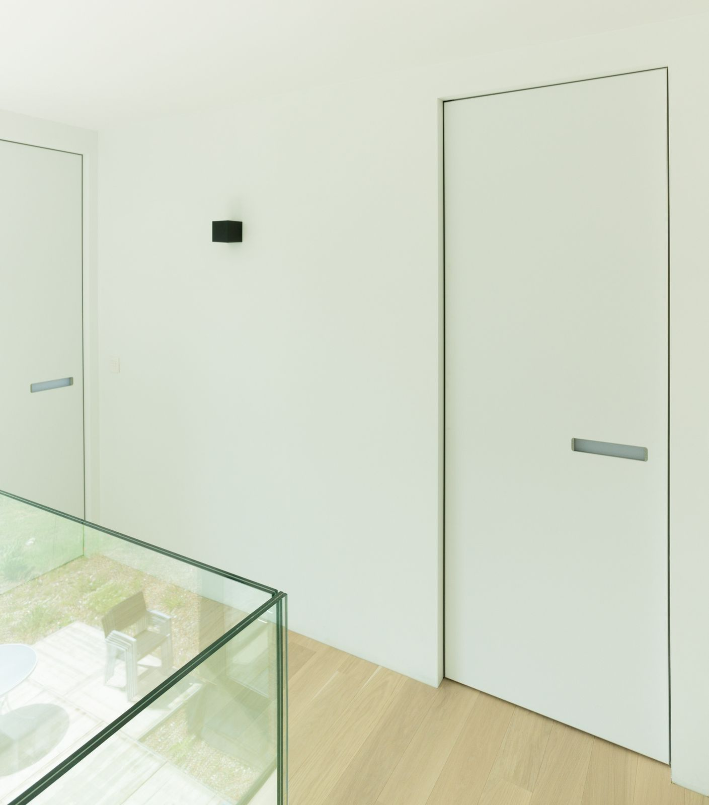 Modern interior doors with invisible door frames. The built-in ...