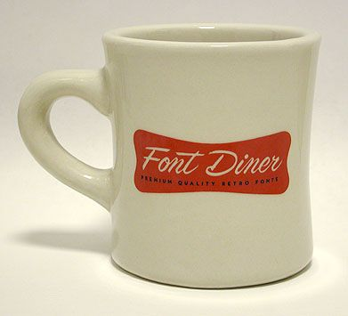 Oatmeal coloured mug with red or navy logo