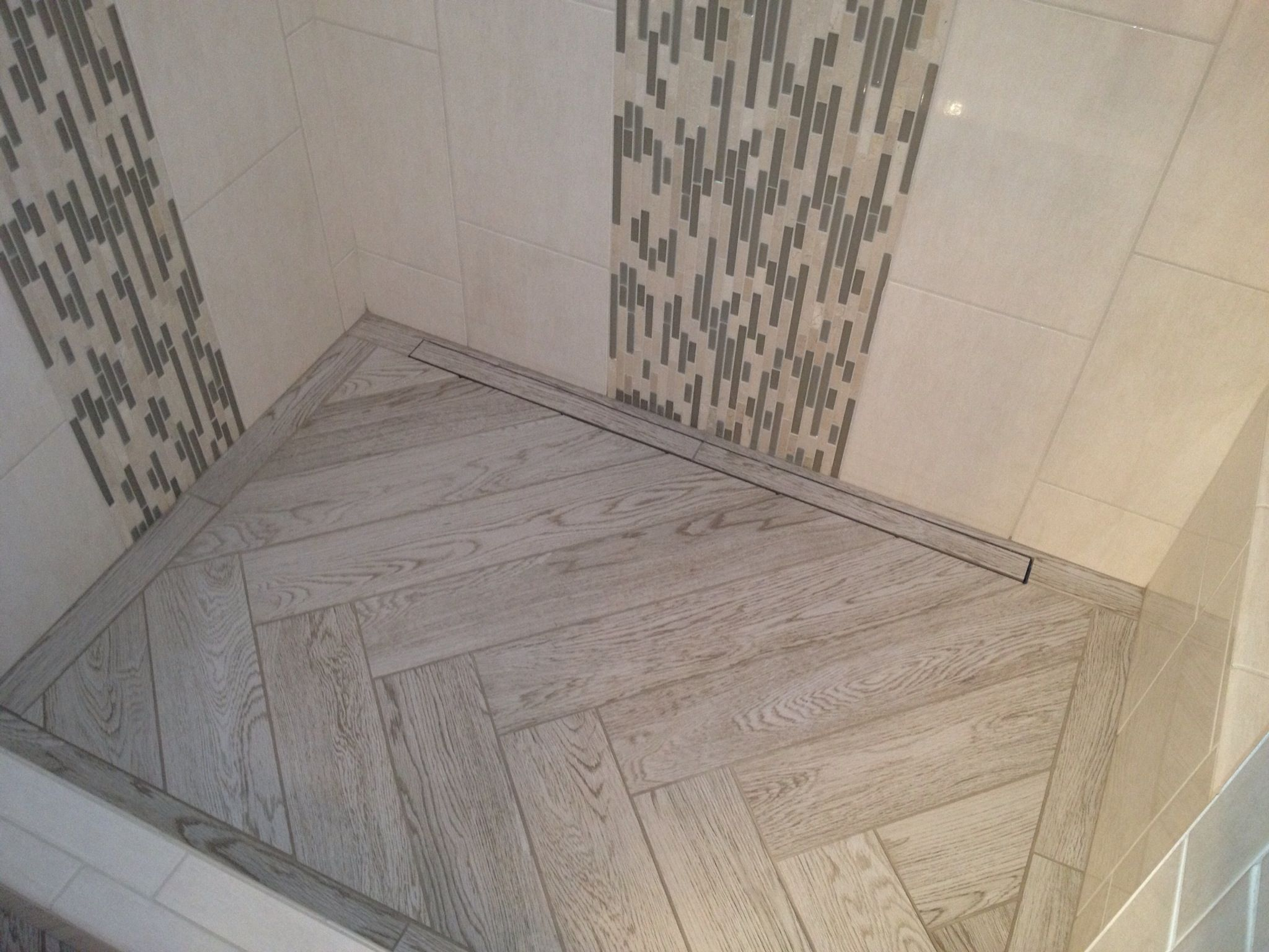 interceramic 39 s scenic in a herringbone pattern on a shower. Black Bedroom Furniture Sets. Home Design Ideas