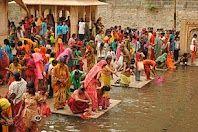 Women in sacred springs in India