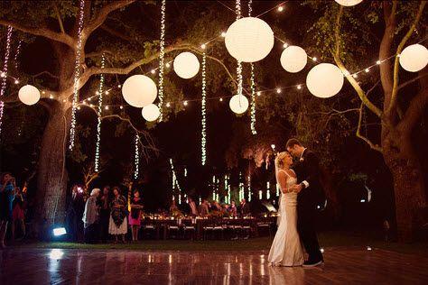 6 - 10 inch lanterns every 4 bulbs along string lights over dance floor