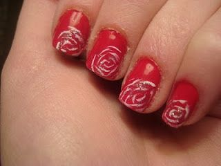 White roses set on red nails.