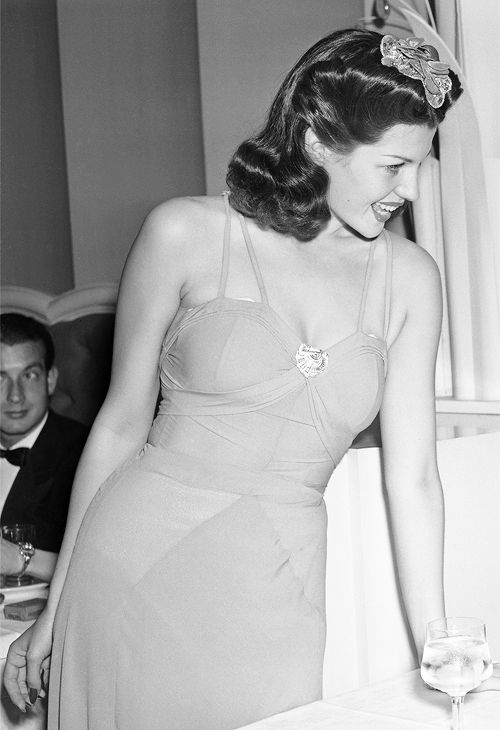 barbarastanwyck:  Rita Hayworth chatting at the Trocadero, 1940