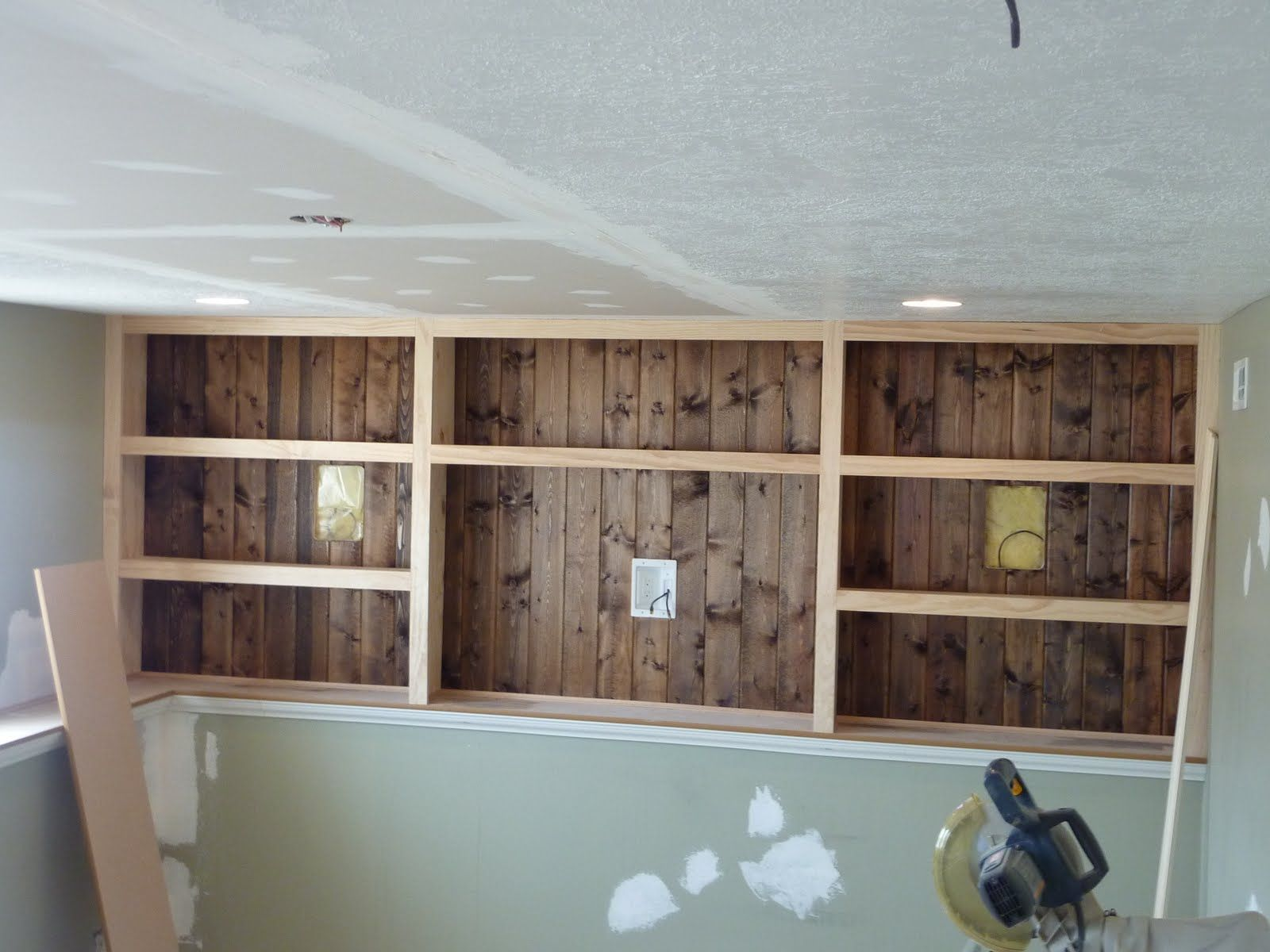 Sassy Sanctuary Progress Report Trim And More Trim Bookshelves Built In Basement Living Rooms Basement Master Bedroom