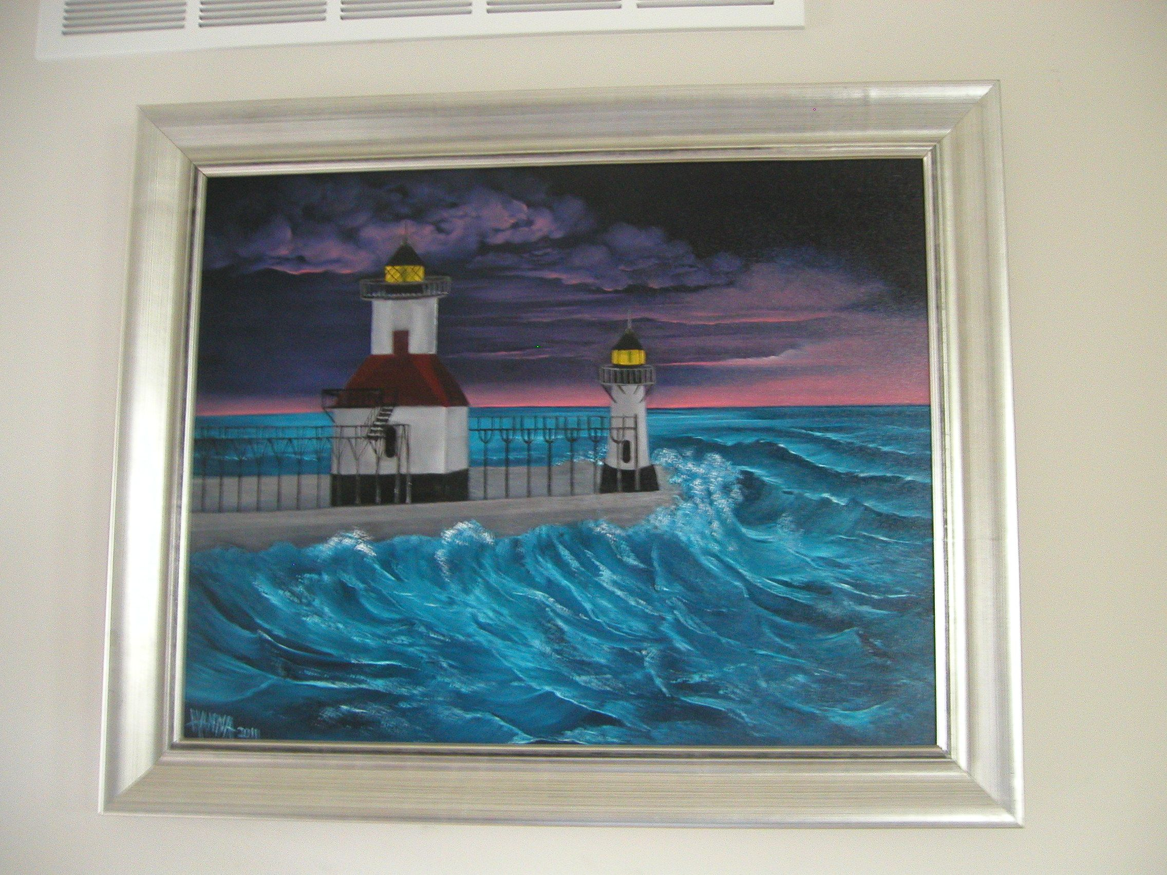 My Granddaughter Danielle is a nurse in St. Joseph, MI and she wanted me to paint her the pier & lighthouses at St. Joseph on Lake Michigan.  After years of boating on the Great Lakes, my favorite time on the water was just after sunset, when the sky is all pink & purple...just before dark. We didn't know what the metal posts were on the pier so the mystery was finally solved when my son-in-law emailed me from St. Joe.  That is a walking bridge in the winter to care for the Lighthouses.