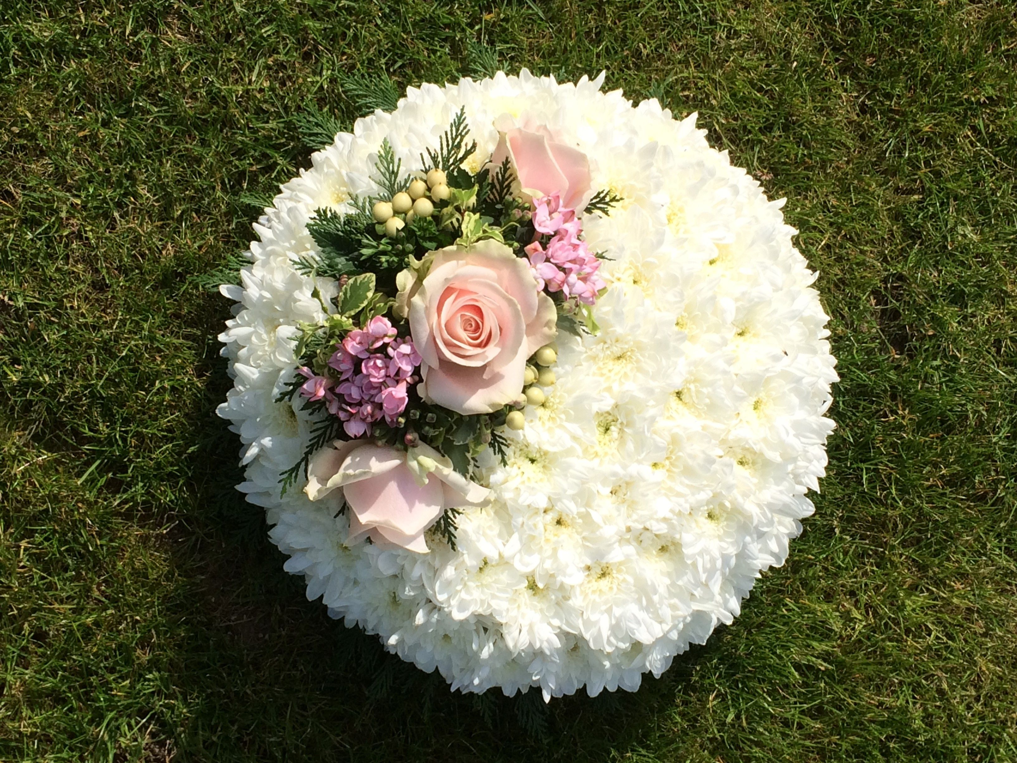 funeral posy pad white chrysanthemum based with floral spray