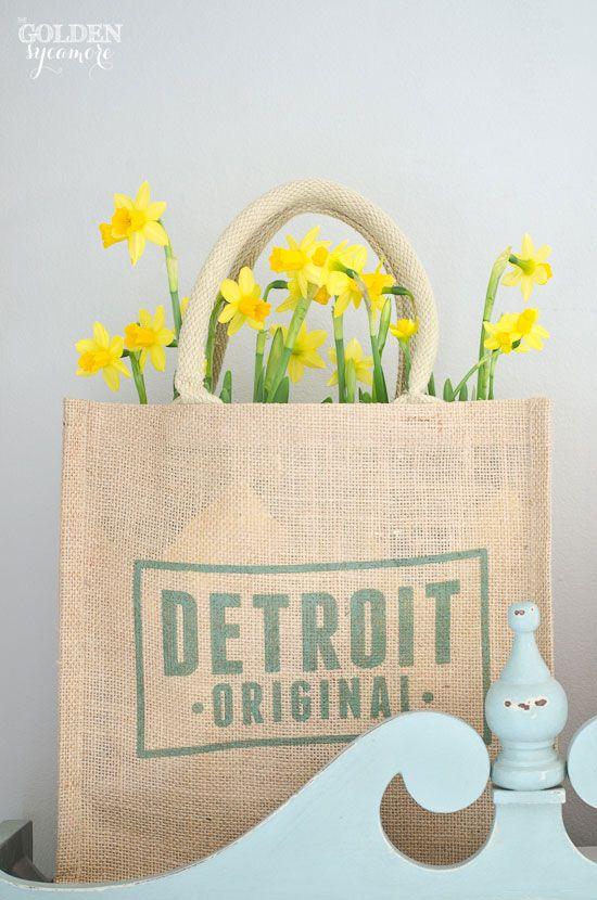 pretty yellow daffodils in burlap sack