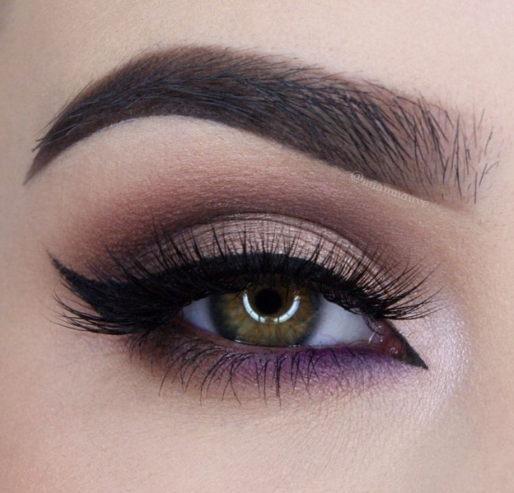Brown with accent of purple under the eyes.