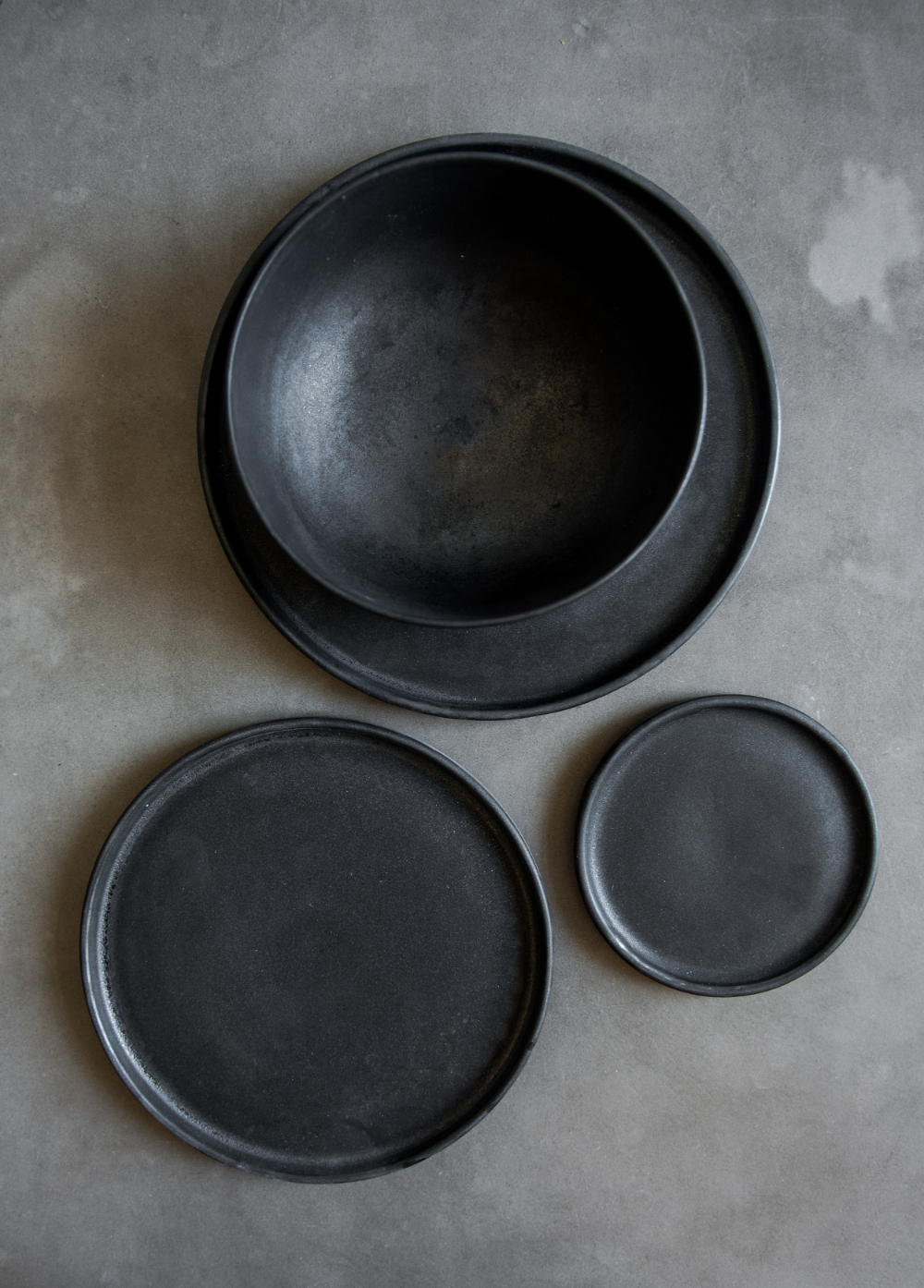 Plates- Older set of bowls and plates, cool medieval aesthetic.