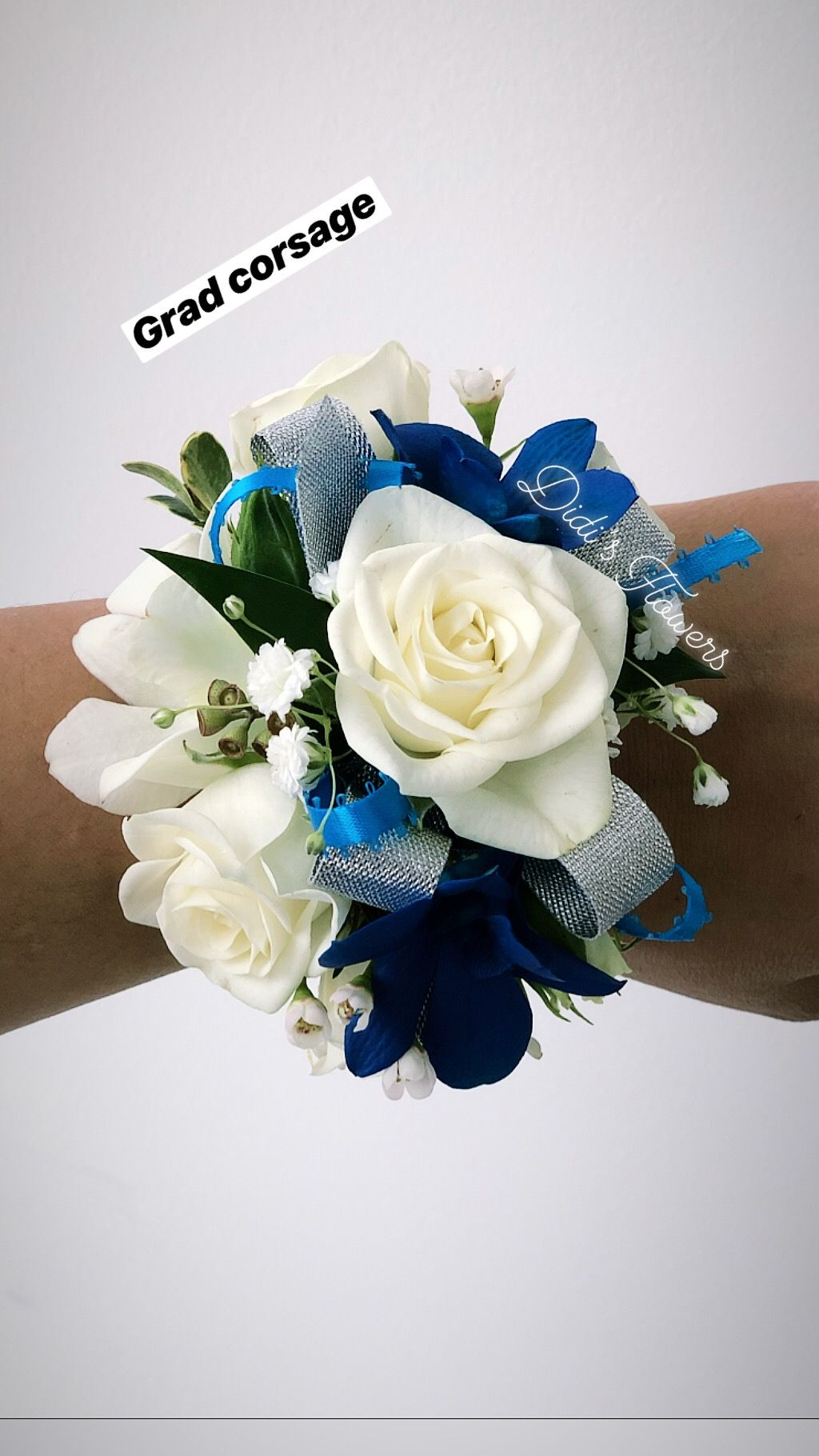 A beautiful blue and white corsage perfect for any prom