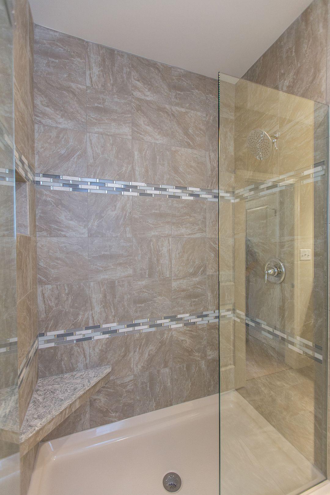Fiberglass Shower Base Tiled Walls And A Quartz Capped Seat Make