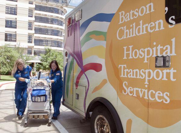 Transport nurses April Davidson, left, and Kathy Hamilton, move an