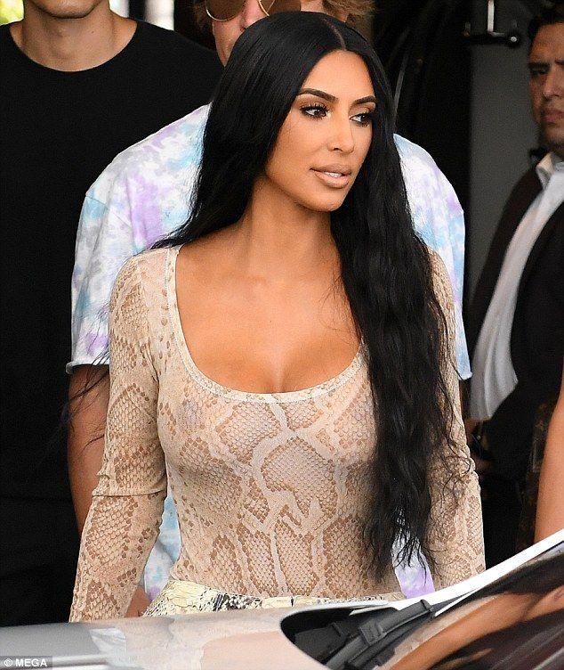 Kim Kardashian sizzles in snakeskin ensemble while out with North