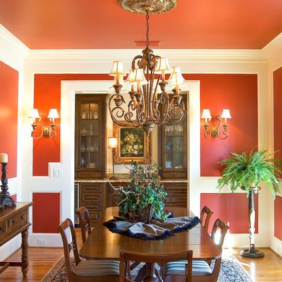 Orange dining room walls and ceiling, white crown molding ...