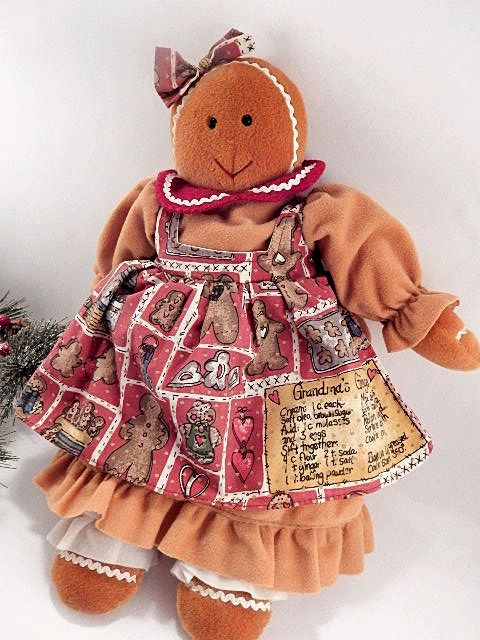 """Adorable gingerbread girl stuffed plush doll Soft sculpture fiber-filled holiday decoration Doll wearing a caramel brown dress with Grandma's Gingerbread Recipe fabric pinafore and white pantaloons 16"""" h x 14"""" l x 4"""" w Cuddly and soft for  Sweet ..."""