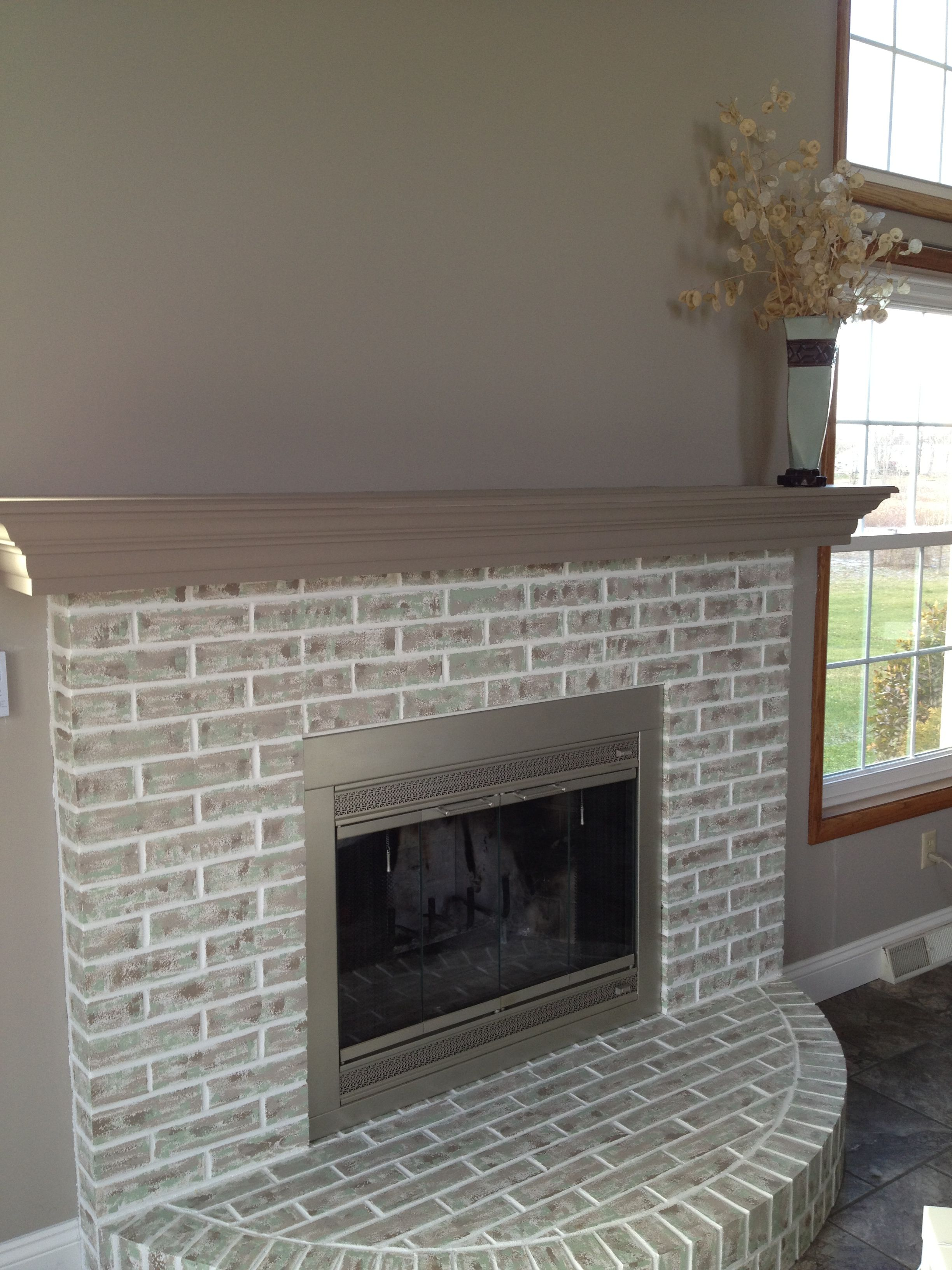completed fireplace painted over red brick painted fireplace