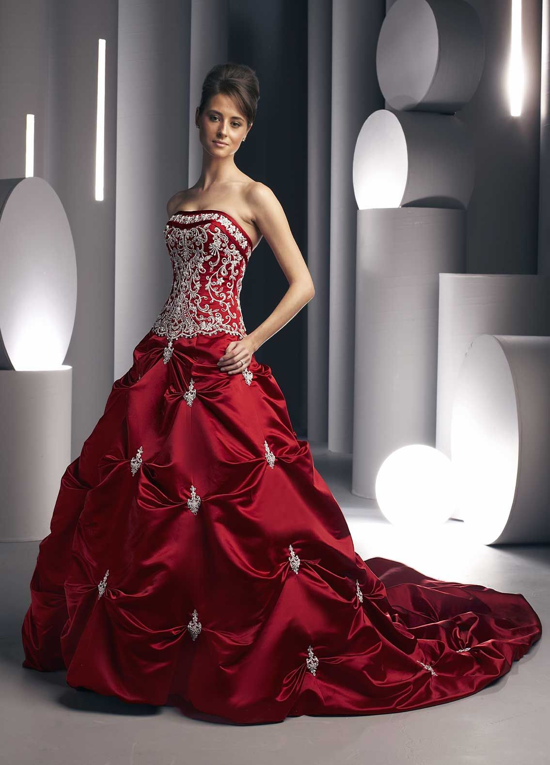 Red ball gown wedding dress  A nontraditional red wedding gown with silver embroidery