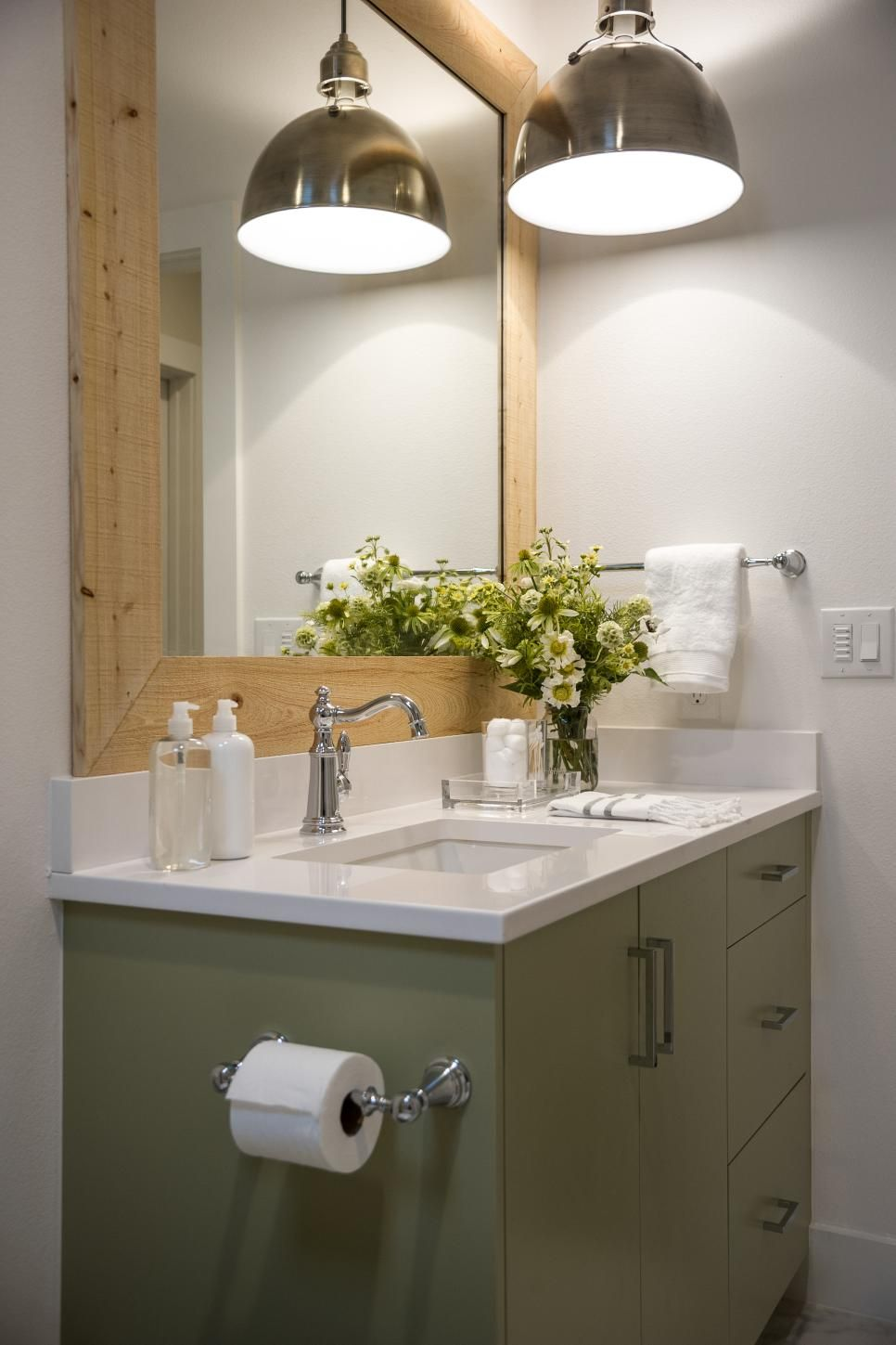 An antique nickel pendant light brightens the bathroom vanity with