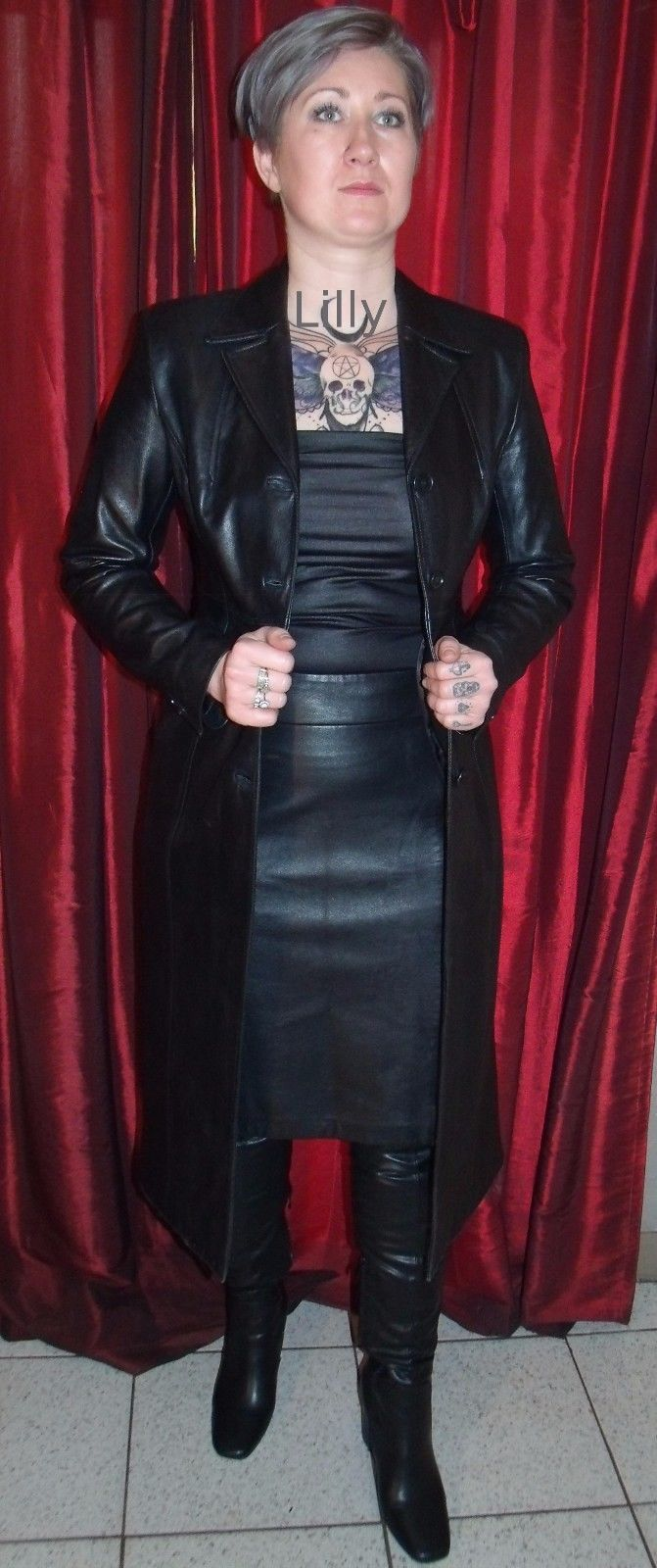 """Karen Millen make ladies long black leather coat, marked size 10, size 8-10 UK, size 6-8 USA, size 34-36 Eur, chest 36"""" maximum, underarm sleeve length 17 """", back length from base of collar to hem 46 """", two flapped front pockets, four buttons, rear vent 23"""". 