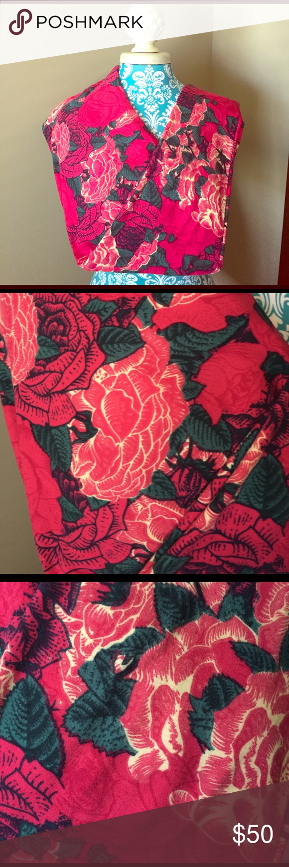 NWT LuLaRoe Rose Leggings 🌹 NWT LuLaRoe Rose Leggings 🌹 Dark magenta background with dark green leaves, yellow accents, black outlining, and several hues of the magenta. Large roses on the entire background in different colors. These are stunning. Tried on. Can no longer wear TC. *CROSS POSTED* LuLaRoe Pants Leggings