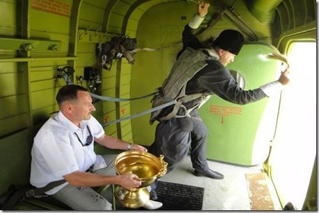 Znalezione obrazy dla zapytania orthodox priest russia holy water from helicopter