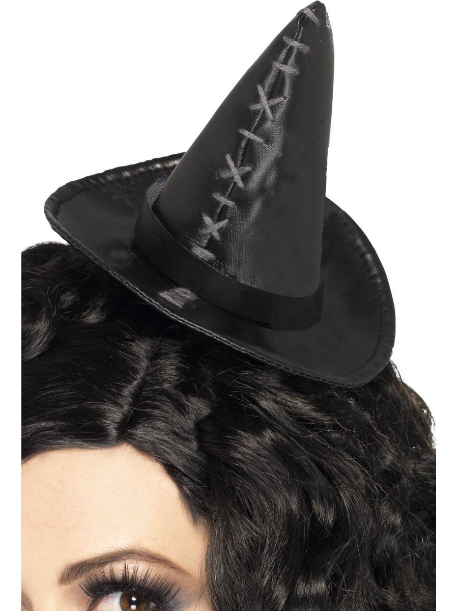 Minihattu: Noitahattu. Pääpanta jossa minihattu. Koristeltu harmailla ompeleilla.