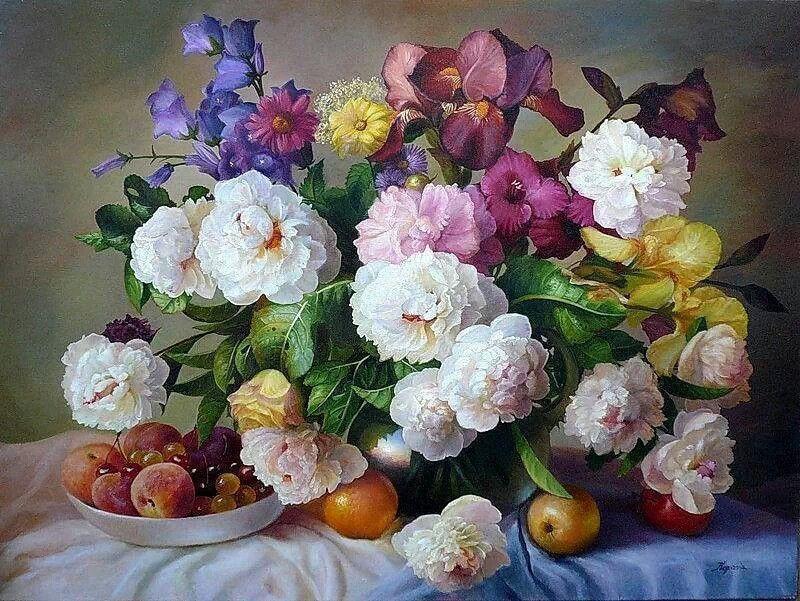 Flores con frutas.