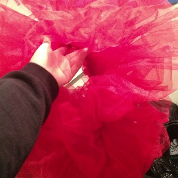 A red tutu Never worn, awesome for raves~ Other