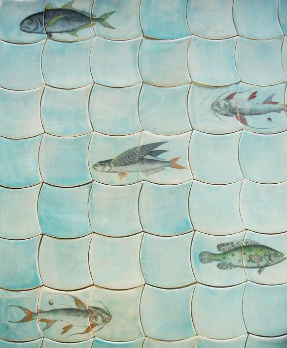 Custom scale shaped tile from Tempest Collection in soft turquoise.