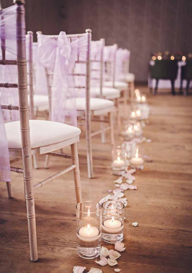Wedding Flowers Ideas Lovely White Flower Petals For Aisle Matched With Roamntic Candles Light In Transparent Glass And Rattan Guests Chairs