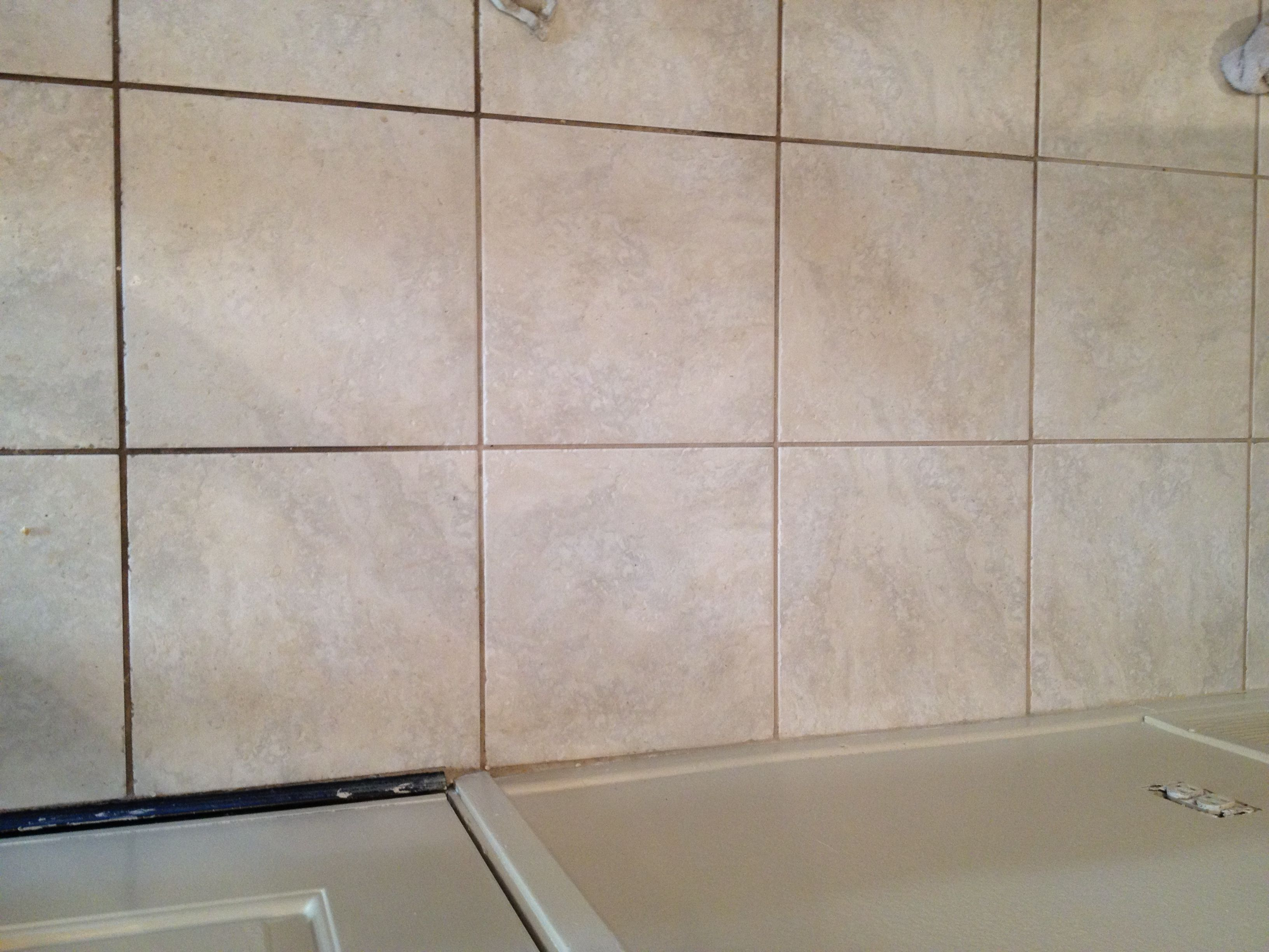 how to make bathroom grout white again