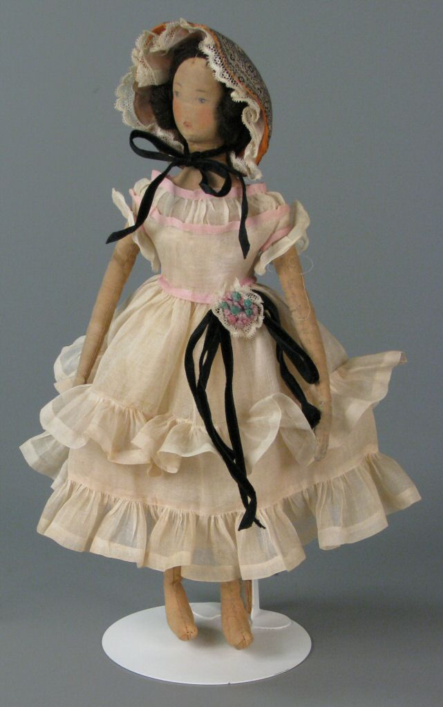 """""""The doll's body is stamped on flesh-color fabric, and has ..."""