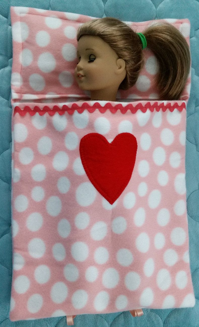 Handmade cute sleeping bag bed for an 18 doll, or Build a Bear Stuffed Animal. It has a built-in pillow, red felt heart, rick rack, ties by NonnasSewingNest on Etsy #bearbedpillowdolls