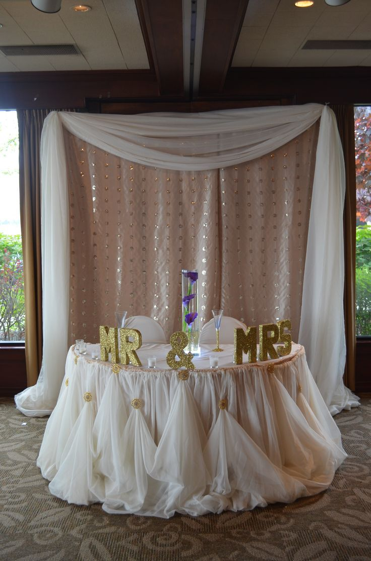 Champagne Sequenced Backdrop With Ivory Cinderella Glam HeadTable Draping In Buffalo Wedding Decor