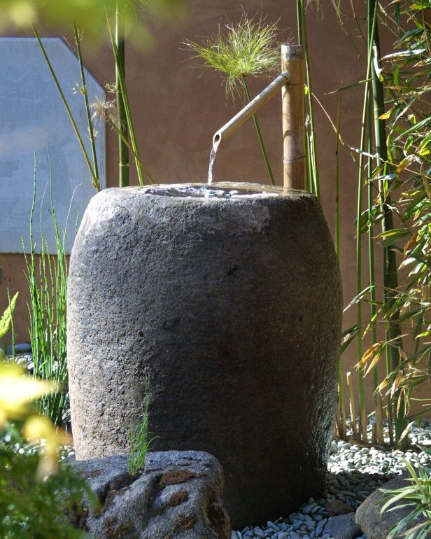 Stone colored fountain with bamboo water feeder