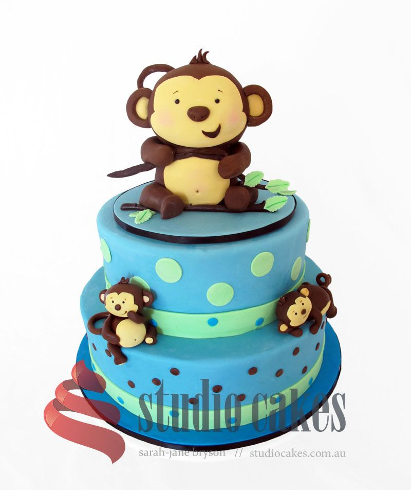 Blue and green cheeky monkey themed cake for a first birthday party