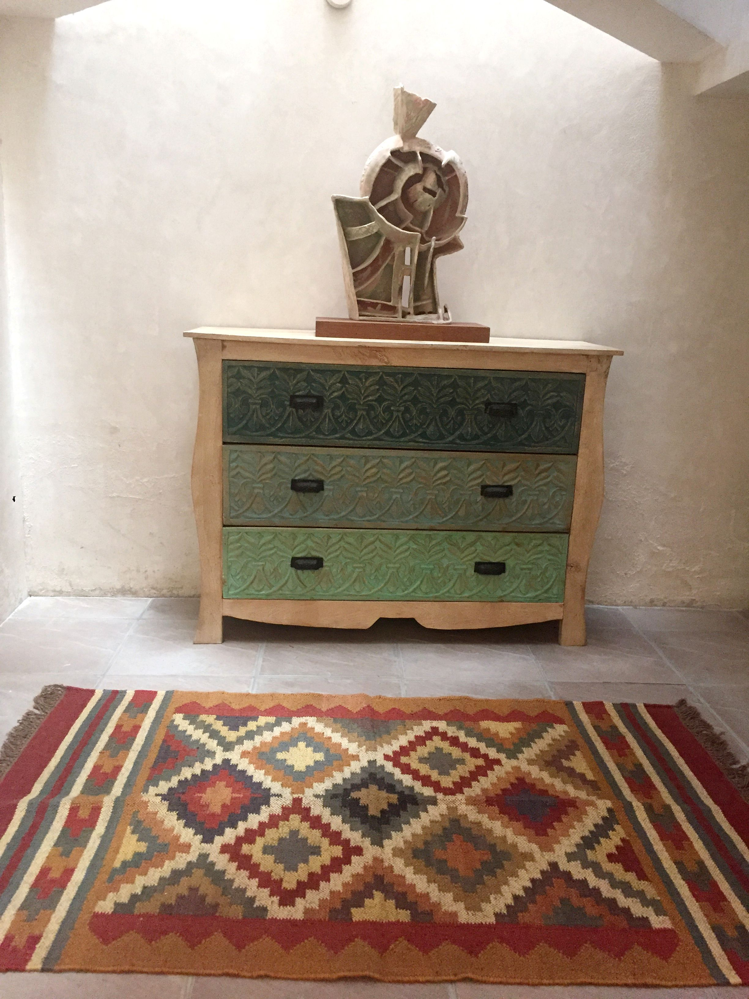 Hand carved chest of drawers with a sand blasted wood frame is