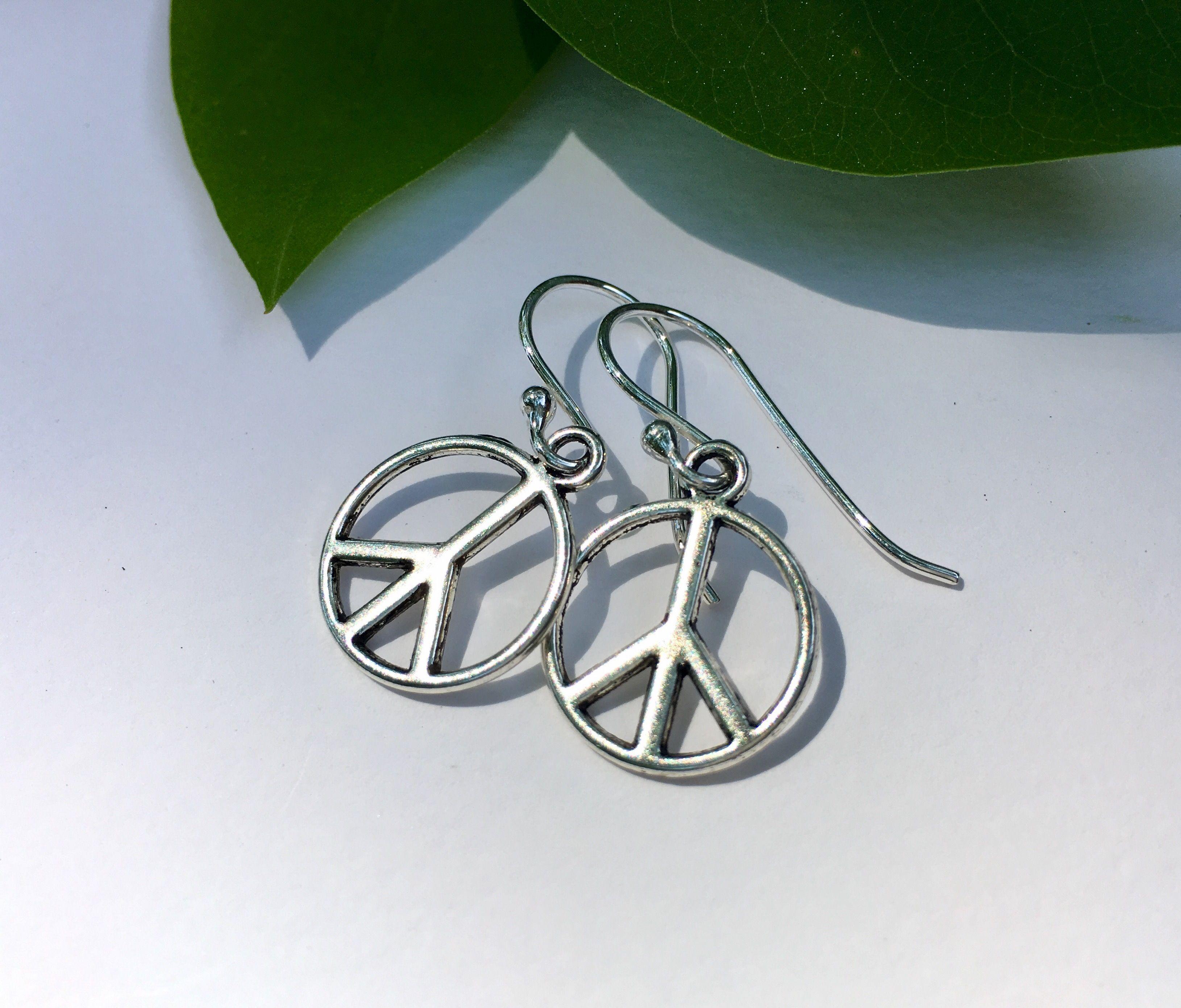 ☮️PEACE sign earrings by JoyfulByNature. Gift idea - share peace :) https://img1.etsystatic.com/123/2/8965783/il_fullxfull.1030755565_13d4.jpg #etsymntt #peace #usa #etsyfinds