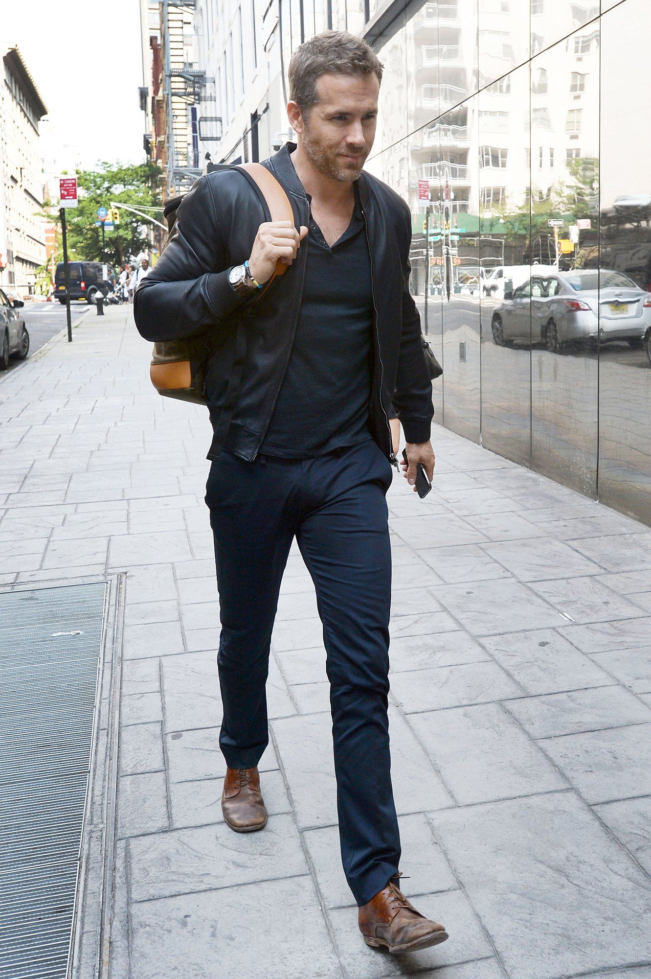 40b5bb8ea6 The Week in Style: 07.10.15 | GQ Ryan Reynolds casual Friday, navy  monochrome, black leather bomber jacket, pants, Henley, backpack brown shoes