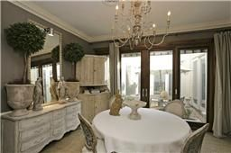 Dining Room with French Doors to the  Atrium make it easy to Entertain. Large furniture and table still can't shrink how spacious and accomo...