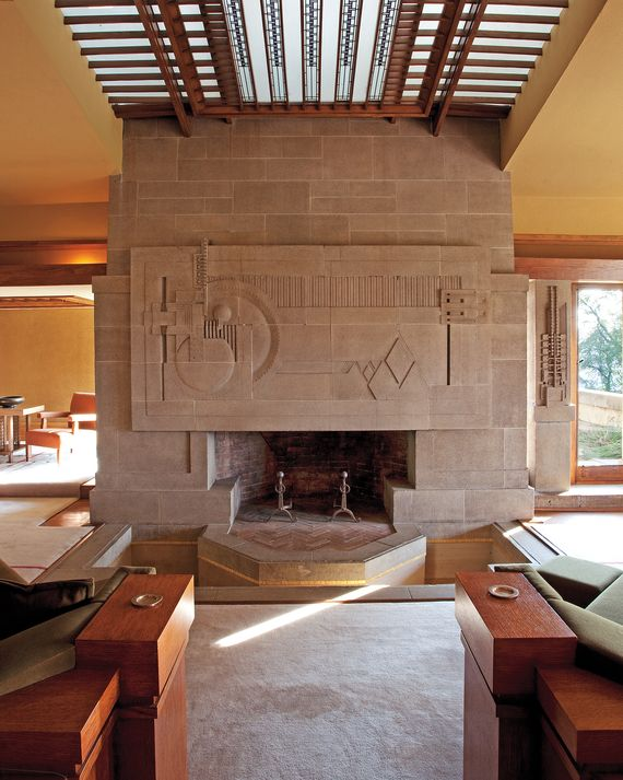 With its abstract frieze of a hollyhock, the fireplace incorporates the elements of fire, earth, and water; its moatlike trough was connected to a pool that flowed under the home.