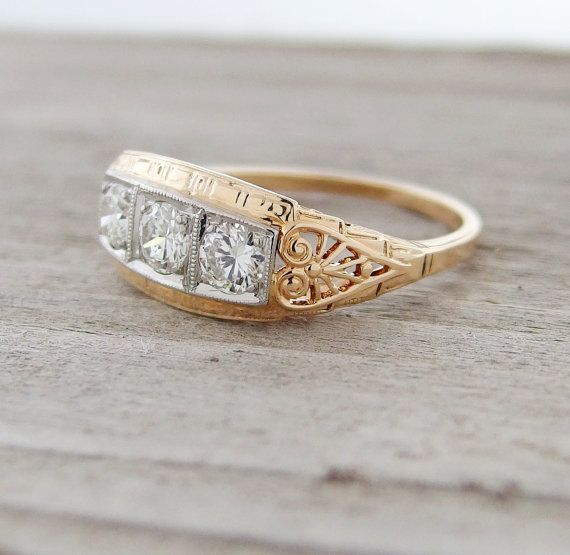 Loving the carved sides on this vintage Art Nouveau three stone ring! Made of 14k yellow gold, white gold, and VVS quality brilliant cut diamonds, circa 1930s.