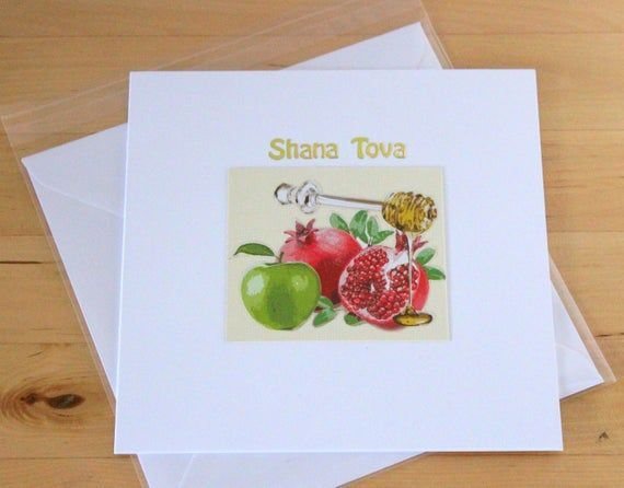 Jewish New Year Card gift, Shana Tova card gift, Rosh Hashana card gift, Jewish Festival Cards, Handmade Jewish cards gifts, Jewish gifts #shanatovacards This Jewish New Year Card gift - Shana Tova card  gift is decorated with Jewish new year's symbols sticker, Irish cream colour background & gold letter stickers. There are 4 options of cards: - Honey, apple & Pomegranete + wording in English. - Shofar & Holly Book + wording in English. - Apple & Pomegranete + wording in Hebrew. - Sofar & Pomegr #shanatovacards