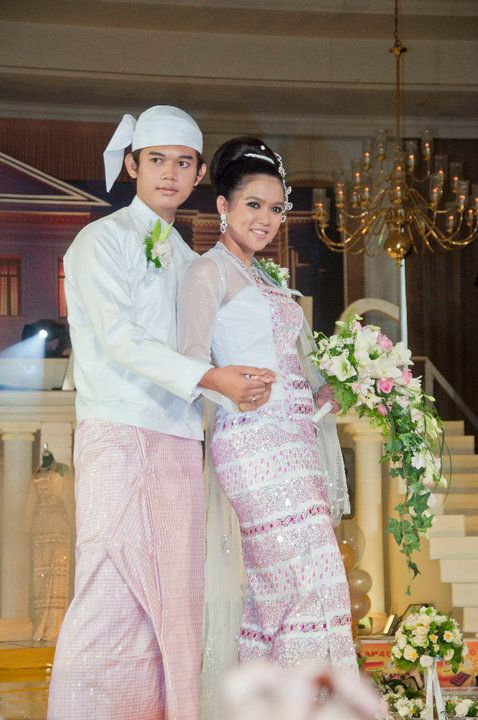 The Bride And Groom In The Traditional Burmese Longyi