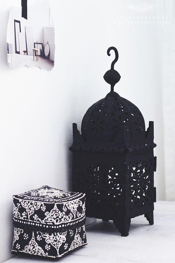 Charcoal Moroccan lantern with a pretty square pouf. #Pouf #Moroccan #Lantern.