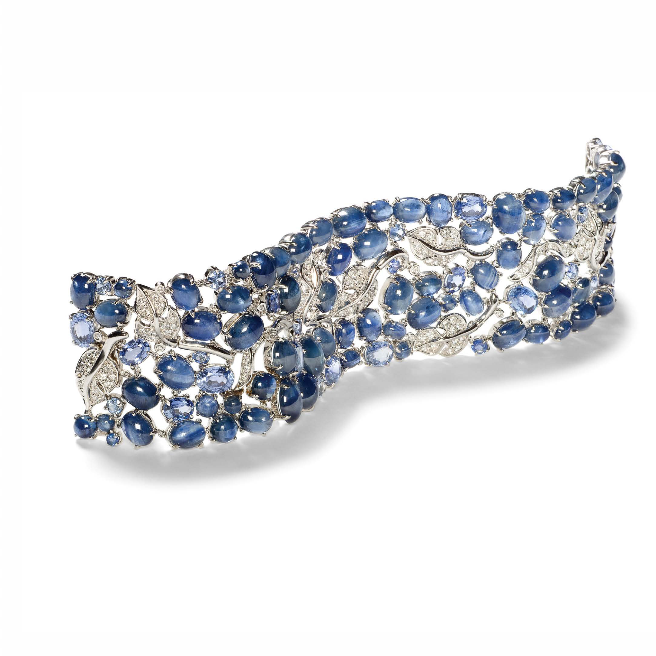 A Vine Bracelet in Sapphire and Diamond set in 18K White Gold.  Signed Seaman Schepps.