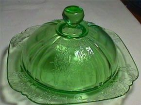 Green depression glass butter dish.