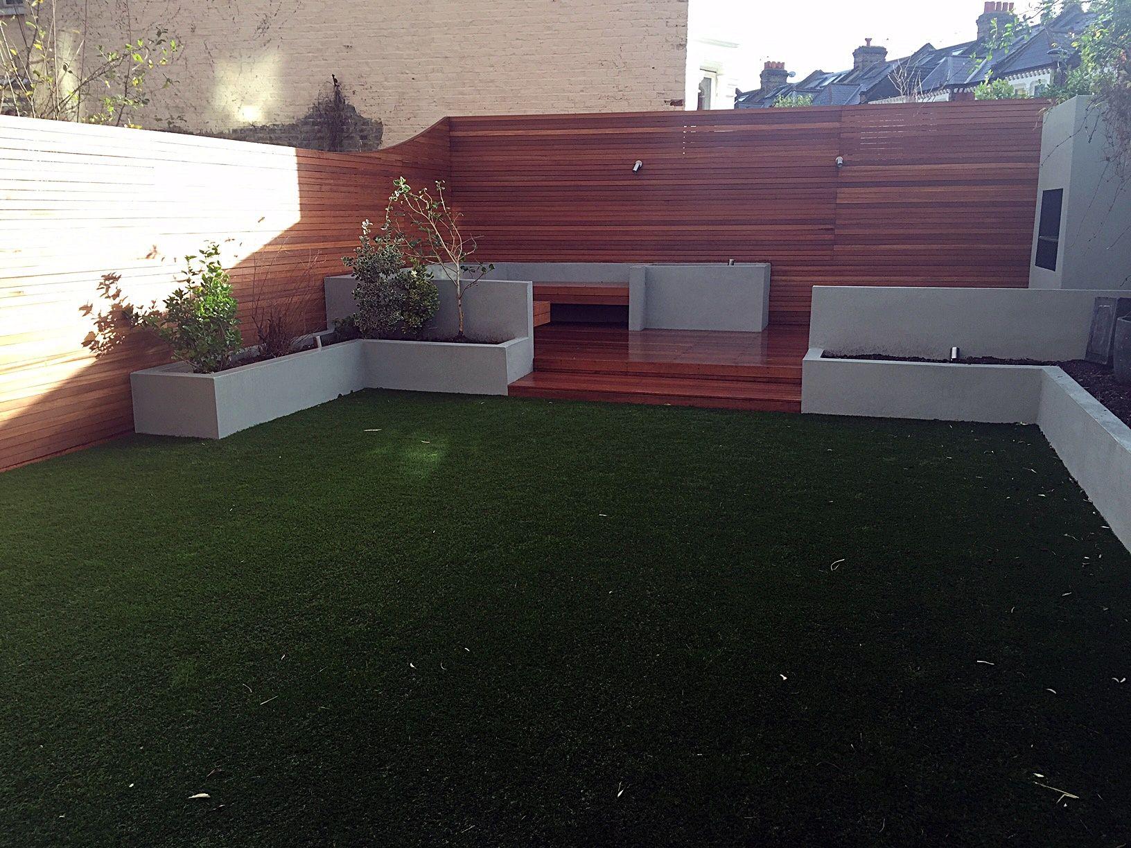 cream tiles pleached trees artificial grass garden lighting