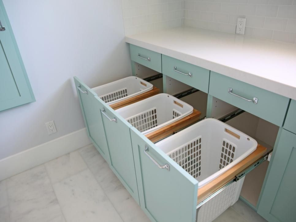 Sorting bins for lights, darks and towels don't have to be front and center. When Erin Rollins of the blog Sunny Side Up was redoing her laundry room, she created drawers that disguise her plastic baskets. Laundry can be such a chore, she says, so I wanted a room that made the process as streamlined as possible. #laundryrooms